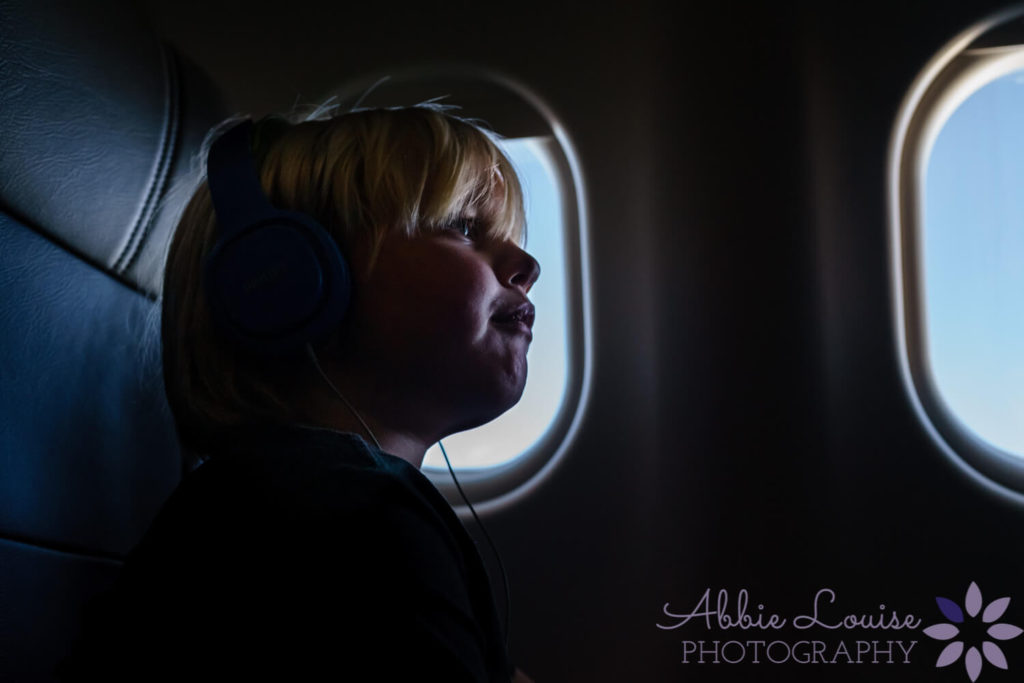 Munich kid enjoying the on board entertainment on an overseas flight