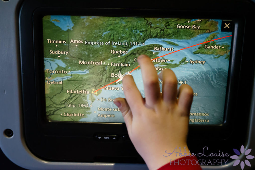 Munich kid hand pointing out the plane on the map