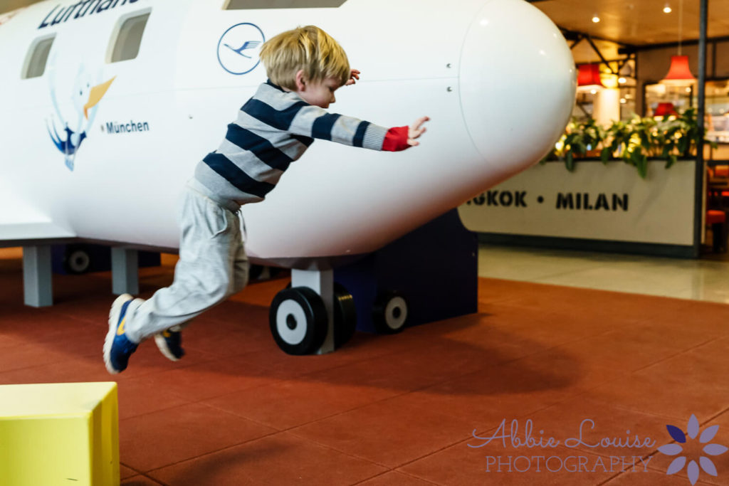 Munich kid jumping around the kids play area at the Munich airport