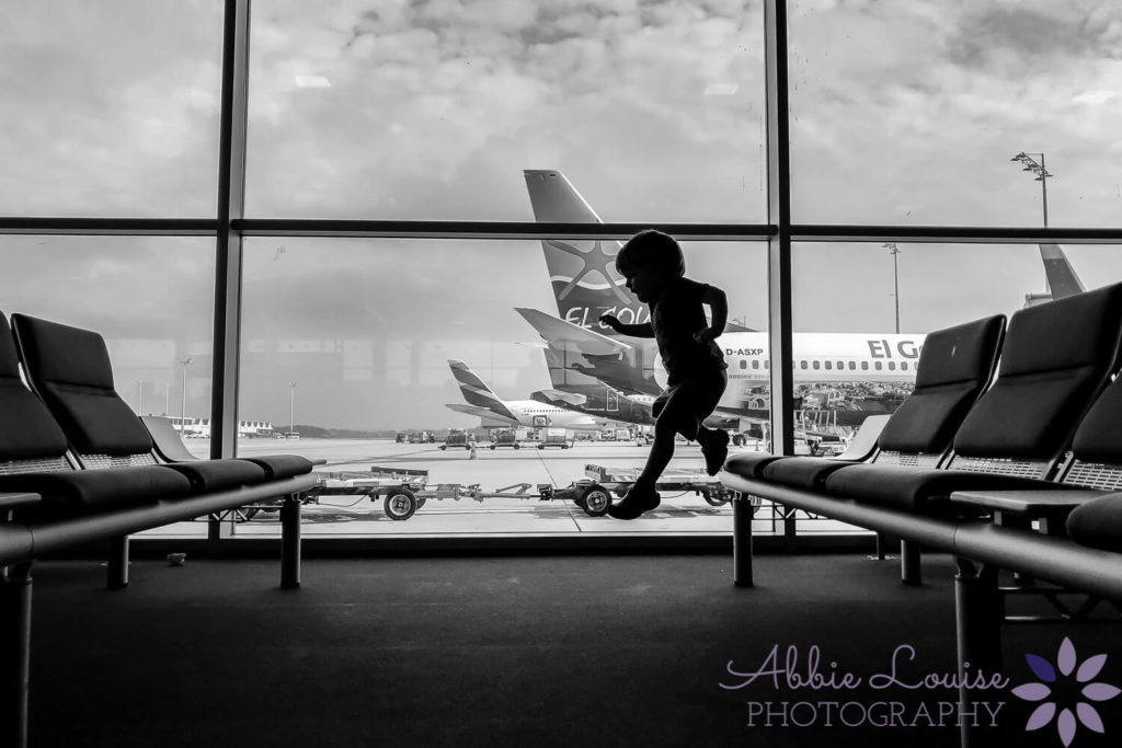 Munich kid jumping around the airport terminal