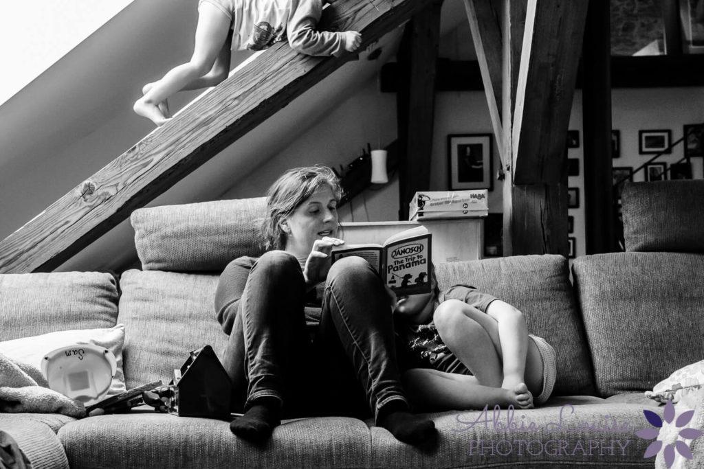 Munich mother reading kids a book
