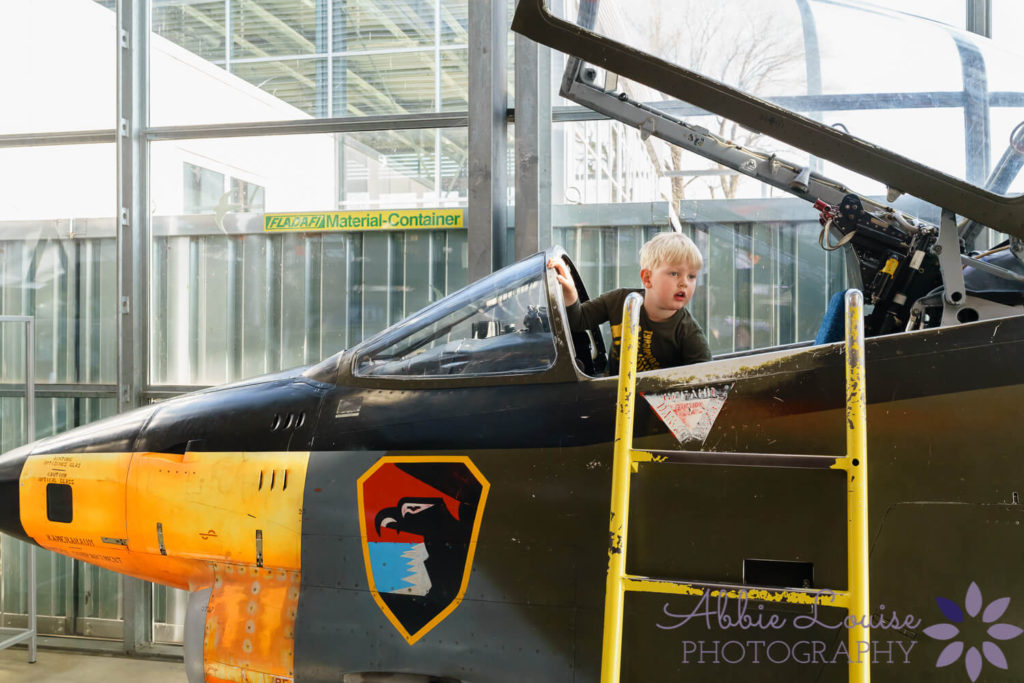 Munich kid in old fighter jet at museum